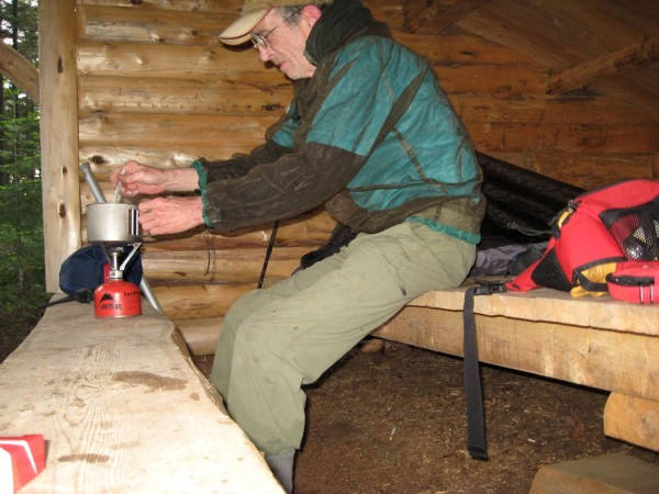 Brad Viles cooks a one pot supper of teriyaki noodles in the Martin Ponds lean-to in Baxter State Park last Tuesday.
