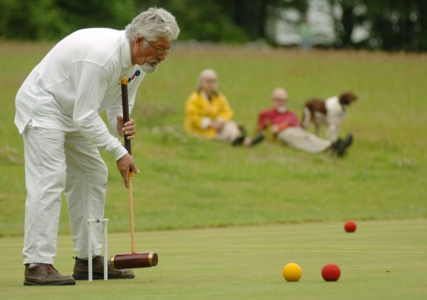 (24) Eric Twigg of Southwest Harbor takes a shot during competition in Ellsworth at the Woodlawn Museum's championship-size croquet lawn during the first Maine and New Hampshire State Croquet Championship in June 2008. Visitors to Woodlawn, a 180-acre historic estate located a quarter mile from downtown Ellsworth, may explore the historic house, go on a hike or play croquet among other activities. For more information, visit http://woodlawnmuseum.com.
