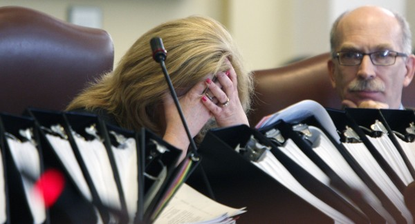 Assistant Majority Leader Debra Plowman, R-Hampden, puts her face in her hands during a long debate on the budget in the Senate at the State House in Augusta on Thursday, June 16, 2011. After many long days and nights of negotiations, the Senate gave their final approval to a $6.1 billion general fund budget. At right is Sen. Richard Rosen, R-Bucksport.
