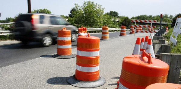 A car navigates around construction on a roadway that connects Topsham to Brunswick on Thursday, June 16, 2011. Maine's legislature gave final approval to a $6.1 billion general fund budget, part of which includes transportation projects.