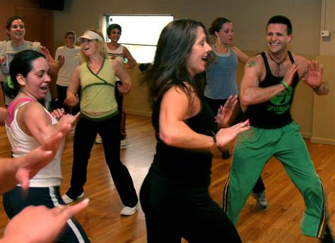 Doug Jones (right) and his wife, Joan (foreground), teach a Zumba class in Dayton, Ohio. Zumba is a mixture of Latin dance and aerobics.
