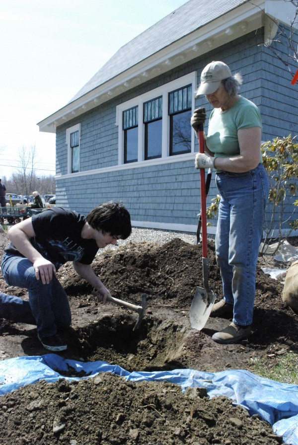 Game Loft volunteer Lucas Merrithew works with Belfast Garden Club president Diane Allmayer-Beck on the Grove Cemetery Gardens in April.