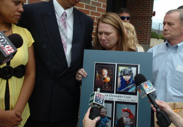 Surrounded by family, Cheryl Metzger holds a display of her slain son, Damien Lynn, following the sentencing of Edgard Anziani on Thursday, June 30, 2011, at the Penobscot Judicial Center in Bangor. In April, Anziani pleaded guilty to the manslaughter of 15-month-old Damien in 2010. Following emotional testimony from both prosecution and the defense, Superior Court Justice Michaela Murphy handed down a sentence of 30 years in prison with all but 25 years suspended.