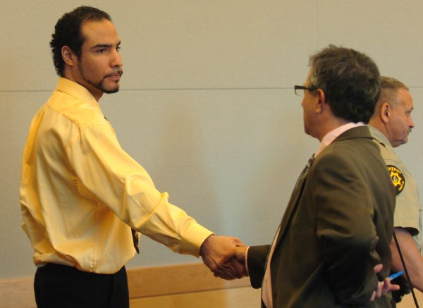 Edgard Anziani shakes hands with his attorney, Jeffrey Silverstein following his sentencing at the Penobscot Judicial Center in Bangor on Thursday, June 30, 2011. Anziani pleaded guilty to manslaughter in April for the 2010 death of 15-month-old Damien Lynn and was sentenced on Thursday to serve 25 years in prison.