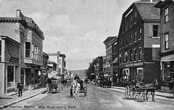 When this view of Main Street looking north was made in 1908, street traffic consisted of horse-drawn buggies and wagons due to Bar Harbor's ban on automobiles. The two wooden shops on the left sold furniture and clothing, while the brick Mount Desert Block on the right housed the Bar Harbor Bank & Trust. Ernest Emery's photography studio occupied the first floor of the block at the far right. Reprinted with permission from Bar Harbor by Earle G. Shettleworth Jr. Photos also available from the publisher online at www.arcadiapublishing.com or by calling 888-313-2665.