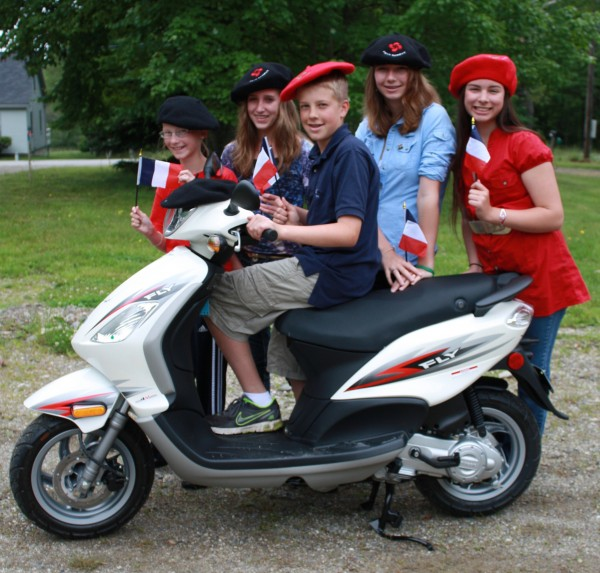 A new Piaggio Scooter from Stanley Subaru of Ellsworth (pictured with some Adams School French exchange students) will be a featured raffle item at the upcoming 2011 Baron's Auction, scheduled for July 7 on the Castine Town Common.