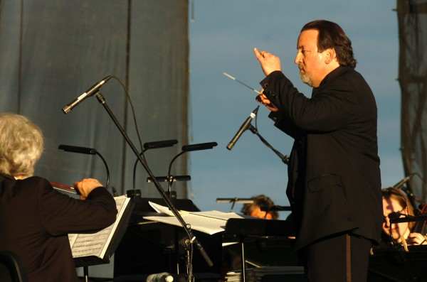 Bangor Symphony Orchestra conductor Lucas Richman leads the symphony during the opening song of Saturday's concert on the Bangor Waterfront. The concert featured Yesterday, a Beatles tribute band.