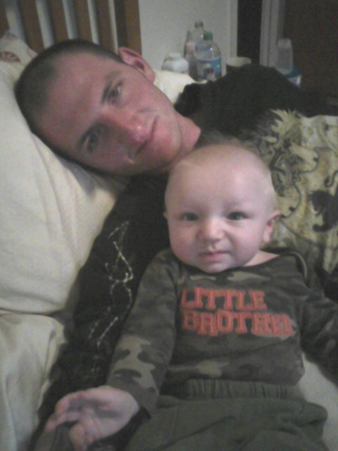 Christopher M. Buzzell and 6-month-old son Jacob.