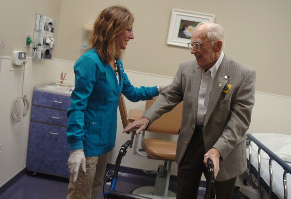 George Carlisle, former president of Prentiss & Carlisle Forest Resource Management and Timberland Services, shares a light moment with phlebotomist Susan Trenholm on Thursday, June 16, 2011, at CancerCare of Maine's Lafayette Family Cancer Center in Brewer. Carlise, who is battling leukemia, recently made a $500,000 donation to the center.