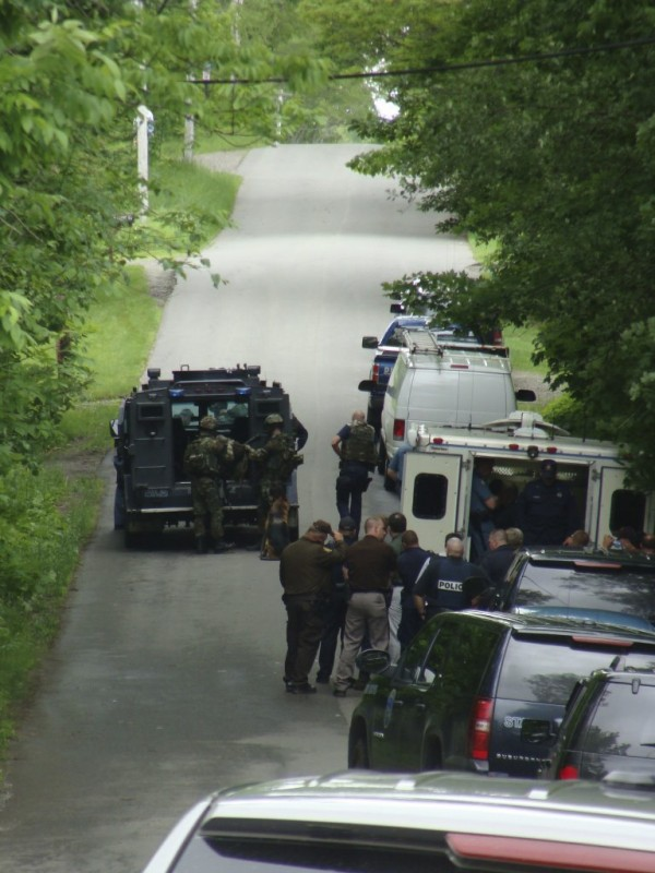 Members of the State Police Tactical Team prepare to enter an amored vehicle before moving it to a home at 173 Shore Road in Dexter. The team entered the home at 2 p.m. after several hours of attempts were made to contact someone in the house. Four bodies were found inside. Steven Lake had murdered his estranged wife Amy Lake and their two children, before killing himself, police said.
