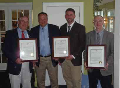 (From left) Stephen B. Rich, WBRC; Charlie Cianchette, Cianbro;, Bruce Cummings, Cianbro; and Larry Parent, UMaine, show off the award given by the Maine Chapter of Construction Specifications Institute.