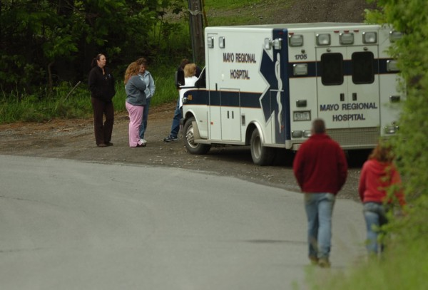 Family members gather on Shore Road in Dexter to await news concerning a domestic incident there.