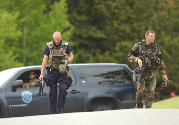 Four people, including two children, were found dead in a house after a standoff that started with reports of shots fired in Dexter.