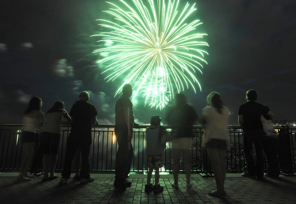 Spectators take in Sunday night's Fourth of July fireworks on Bangor's waterfront on July 4, 2010.