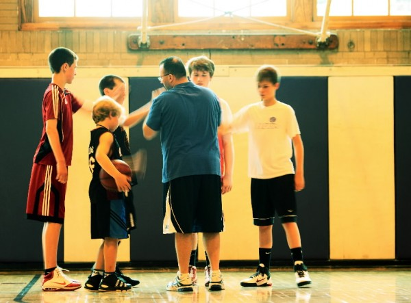 Tony Staffiere, center, finishes a basketball class with boys in grades 6-8 at the Gilman Street Basketball Club in Waterville on Sunday, June 26, 2011. The boys were being taught the concept of playing three-on-three, in preparation for playing five-on-five basketball.