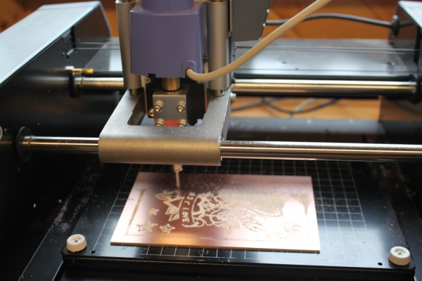 A precision building machine etches a printmaker's intricate floral pattern into a piece of copper Tuesday, June 14 in the new Fab Lab at Haystack Mountain School of Craft in Deer Isle.