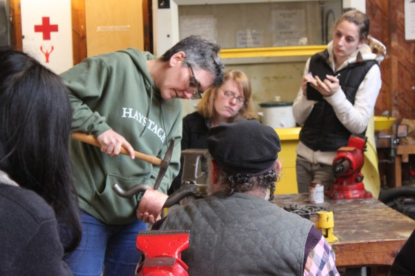 Instructor Myra Mimlitsch-Gray of New Paltz, New York, demonstrates how to bend copper on a horn Tuesday, June 14 in the metalworking studio at Haystack Mountain School of Craft in Deer Isle.