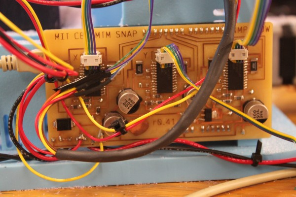 The circuit board of MTM (Machines That Make) Snap, a machine invented by MIT graduate student Jonathan Ward of Arkansas, is being tested at the new Fab Lab in Haystack Mountain School of Craft in Deer Isle. The machine is used to convert digital designs into physical objects, such as Lego-shaped blocks.