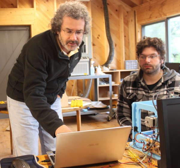Neil Gershenfeld (left), director of the Massachusetts Institute of Technology Center for Bits and Atoms and founder of the Fab Lab program, works with MIT graduate student Jonathan Ward of Arkansas on Tuesday, June 14, 2011, in the new Fab Lab at Haystack Mountain School of Craft in Deer Isle.