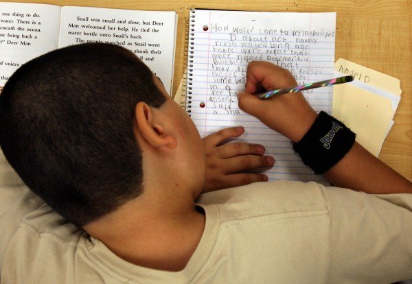 Angel Diaz, 9, works on a paper in Oct. 2008. Children are texting, tapping and typing on keyboards more than ever, leaving less time to master that old-fashioned skill known as handwriting.