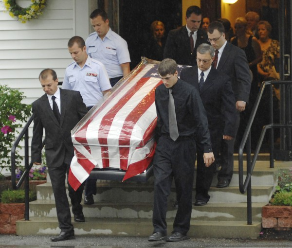 The flag-draped coffin of Richard Jeskey was carried by pallbearers after services held for him Saturday, June 25, 2011, at the Calvary Baptist Church in Brewer.