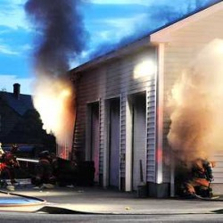 Lewiston firefighters douse garage, snowmobile fires