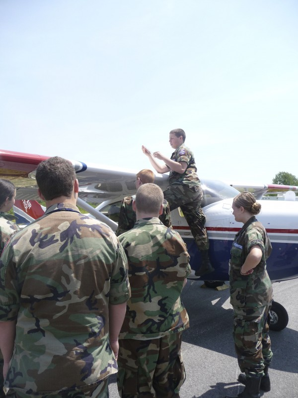 Brandon St. Louis of the Machias Civil Air Patrol shows fellow cadets how to check the fuel level of one of the CAP planes at Machias Airport on Friday afternoon. Eight cadets flew Friday from Machias to Rockland and back as part of their aeronautical training, including four cadets who had never been in a plane before. The Machias chapter of the CAP is one of the oldest in the state and has 15 active cadets. St. Louis plans to apply to Annapolis when he graduates high school and fly helicopters for the U.S. Marines.