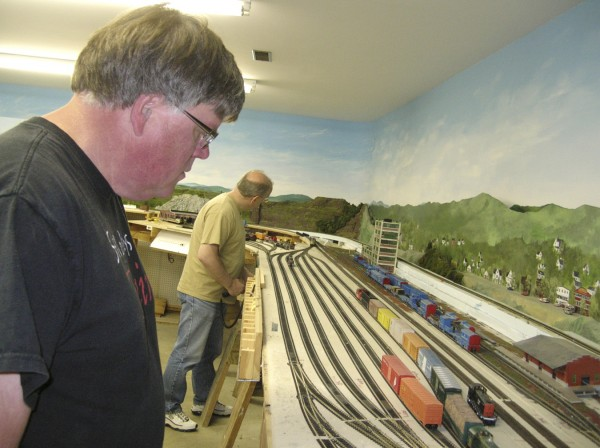 Geoff Anthony and Dave McDonald of the Eastern Maine Model Railroad Club check out some of the engines on the club's layout recently.