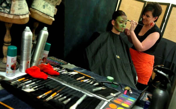 Make-up artist Kristin Collins, on right, transforms model Allyson Holmbom to resemble a serpent on Tuesday, June 1, 2011, at Empire Beauty School in Bangor. Collins recently traveled to Hershey, Pennsylvania, where she placed first in a national cosmotology competition. A native of Greenville, Collins aspires to someday do theatrical make-up for films and television