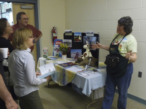 Jane Bell (left) of Tide Mill Farm explains the products and history of the farm, located in Edmunds, at a &quotMeet Your Farmer&quot event held Wednesday night at the University of Maine at Machias.