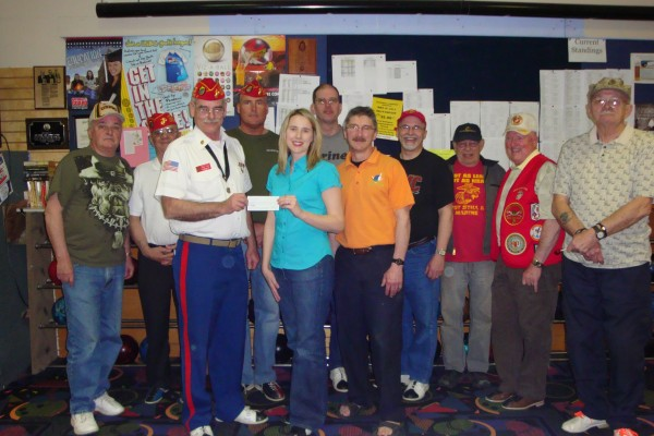 On April 30, the Military Order of the Devil Dogs, Moose Pound #255, Pack of Maine, Marine Corps League held a Bowl-a-Thon Fundraiser at the Family Fun Bowling Center in Bangor for the Pediatrics Ward-Grant 8 at Eastern Maine Medical Center. Members presenting a check for $1766.25 to Renee Wyatt, child life specialist at EMMC, are (from left) Richard Stitham, Reggie Earley, Steve Fleming, Bill Jones, Wyatt, Richard Vargas, Family Fund Manager Andy Meucci, Ervin Dumond, Sonny Goodwin, Don Polk and Richard Dekoschak.
