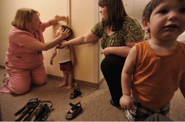 Patricia Cook, C.N.A. (left) measured the height of three-year-old Henry Wortman of Wytopitlock as his mother, Angela Wortman (second from right) and his little brother Michael (right), 18 months, were by his side during Henry's doctor appointment at Eastern Maine Medical Center Wednesday afternoon, June 1, 2011. Angela Wortman and her mom Debi Perry (not pictured) of Lincoln brought the boys to EMMC, concerned that Henry having a recurring case of constipation. Angela Wortman was only 27 weeks pregnant when she gave birth to Henry via an emergency Cesarean. He weighed a mere one pound and seven ounces. With the help of EMMCand the  Children's Miracle Network, Henry left the hospital 122 days later. On Saturday, June 4, Waterfont Concerts' benefit show, featuring the Beatles tribute band Yesterday Productions and the Bangor Symphony Orchestra,  will donate proceeds from the ticket sales to Eastern Maine Children's Charities and the Children's Miracle Network.