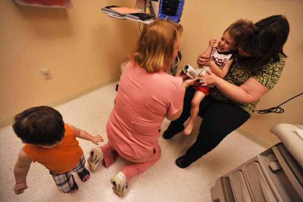 Preparing to take his temperature, Patricia Cook, C.N.A. (left) coaxes three-year-old Henry Wortman of Wytopitlock as his mother, Angela Wortman, left, and his little brother Michael (lower left), 18 months,  and his grandmother, Debi Perry (not pictured) of Lincoln were by his side during Henry's doctor appointment at Eastern Maine Medical Center Wednesday afternoon, June 1, 2011. Angela Wortman and her mom Debi Perry (not pictured) of Lincoln brought the boys to EMMC, concerned that Henry having a recurring case of constipation. Angela Wortman was only 27 weeks pregnant when she gave birth to Henry via an emergency Cesarean. He weighed a mere one pound and seven ounces. With the help of EMMCand the  Children's Miracle Network, Henry left the hospital 122 days later. On Saturday, June 4, Waterfont Concerts' benefit show, featuring the Beatles tribute band Yesterday Productions and the Bangor Symphony Orchestra,  will donate proceeds from the ticket sales to Eastern Maine Children's Charities and the Children's Miracle Network.