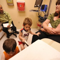 Dr. Mohammad Tabbah (top left), M.D., a pediatric gastroenterologist, talked with Angela Wortman (right) of Wytopitlock  about her her three-year-old son Henry (second from right) whom she brought to Dr. Tabbah at EMMC  for an appointment Wednesday afternoon, June 1, 2011. Angela Wortman and her mom Debi Perry (not pictured) of Lincoln brought the Angela's sons Henry and 18-month-old Michael to EMMC, concerned that Henry was having a recurring case of constipation. Angela Wortman was only 27 weeks pregnant when she gave birth to Henry via an emergency Cesarean. He weighed a mere one pound and seven ounces. With the help of EMMC and the  Children's Miracle Network, Henry left the hospital 122 days later. On Saturday, June 4, Waterfont Concerts' benefit show, featuring the Beatles tribute band Yesterday Productions and the Bangor Symphony Orchestra,  will donate proceeds from the ticket sales to Eastern Maine Children's Charities and the Children's Miracle Network.