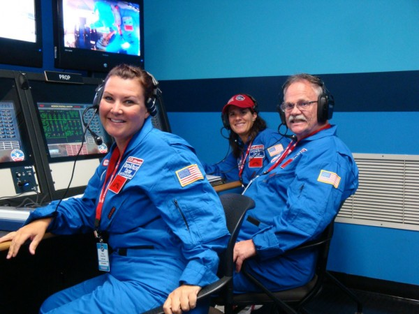 Orono fifth grade teacher Stephen Whitney (right) works the control panel during a simulated space flight with two other teachers earlier this month at the Honeywell Space Academy in Huntsville, Ala.