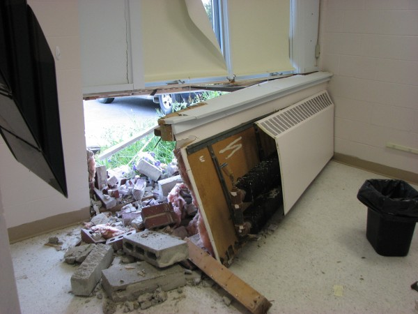 The Newburgh town office was damaged Thursday evening when it was accidentally hit by a van driven by a former selectman.