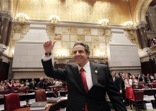 New York Gov. Andrew Cuomo reacts after same-sex marriage was legalized after a vote in the Senate Chamber at the Capitol in Albany, N.Y., on Friday, June 24, 2011.