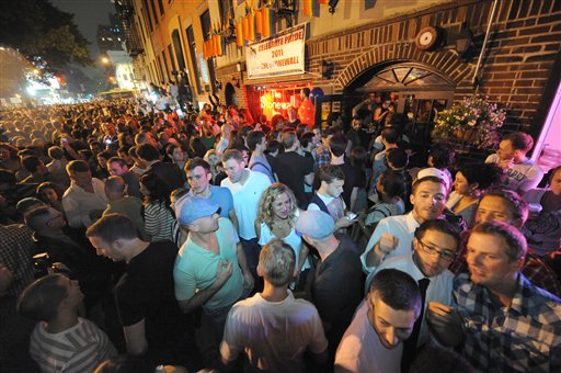 Revelers celebrate in Manhattan's west village after the passage of the same=sex marriage bill by a 33-29 vote, Friday, June 24, 2011, in New York. Same-sex marriage is now legal in New York after Gov. Andrew Cuomo signed a bill that was narrowly passed by state lawmakers Friday, handing activists a breakthrough victory in the state where the gay rights movement was born.
