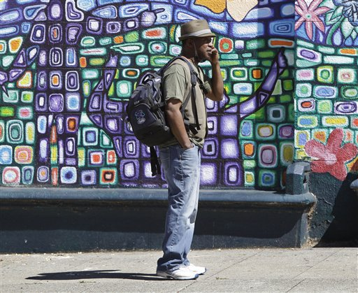 A unidentified man uses a cell phone in Oakland, Calif., Tuesday, June 14, 2011. Despite all the recent news about possible cancer risks from cellphones, coffee, styrene and formaldehyde in building materials, most people face little if any danger from these things, health experts say.