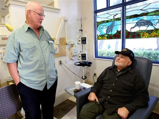 Calvin Baxter, left, and Merle Clark chat as they wait during their cancer treatments at the Lakeland Regional Cancer Center last month. The two men, who are among the first in the nation in a clinical trial for Isis, a prostate cancer drug, have become friends after meeting for treatments.