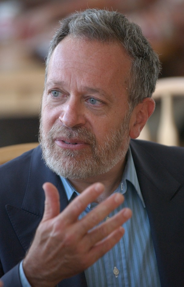Former Labor Secretary Robert Reich talks during an economic roundtable discussion at the Bagel Central in Bangor in 2004.