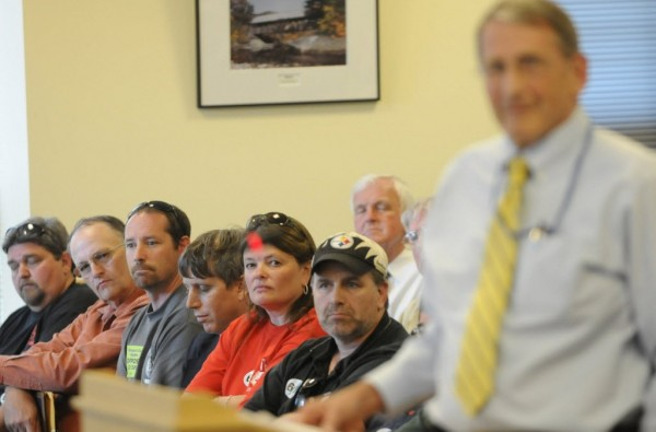 Maine union members and their labor representives listen to LD 390 lead sponsor Tom Winsor (right), R-Norway, argue for the bill during a public hearing before the Labor, Commerce, Research and Economic Development Committee in Augusta late Thursday afternoon, June 2, 2011.