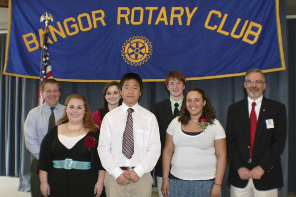 Rotary Club of Bangor presented five Youth Merit Scholarships during its June 7 meeting. Pictured are (front row, from left) Kate Wypyski, Brewer High School; Keji Xu, Bangor High School; Tynesha Dias, Bangor High School; and David Green, Rotary Club president; (back row) Shawn Yardley, Rotary scholarship chairman; Jennifer Morrill, John Bapst Memorial High School; and Andrew Babbitt, John Bapst Memorial High School.