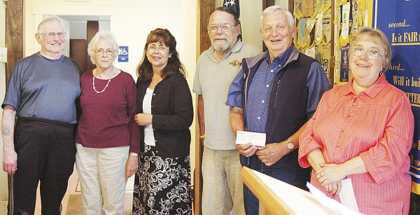 The Belfast Rotary Club recently made its annual donations to area food cupboards and the Belfast Soup Kitchen from the proceeds of its pancake breakfasts. Club member Marjorie Crowley (third from left) gave out the donations to (from left) Cleo and Donna Alley of Northport Food Cupboard, Alex Allmayer-Beck of the Belfast Soup Kitchen, Ralph Harvey of the Searsport Methodist Church Food Cupboard and June Clark of the Greater Bay Area Ministerium Food Cupboard. The Rev. Scott Baker of the Little River Baptist Church was not present to accept its donation. Crowley reported that the Alleys said the Northport Food Cupboard was feeding 35-40 households when they took over four years ago, but last month it was 117.
