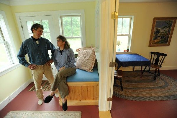 Jim Bahoosh and his partner Martha Garfield pose for a picture on Saturday, June 25, 2011, in the living area of Garfield's home that Bahoosh recently built. Bahoosh prefers to build small homes with little unused space or building waste.