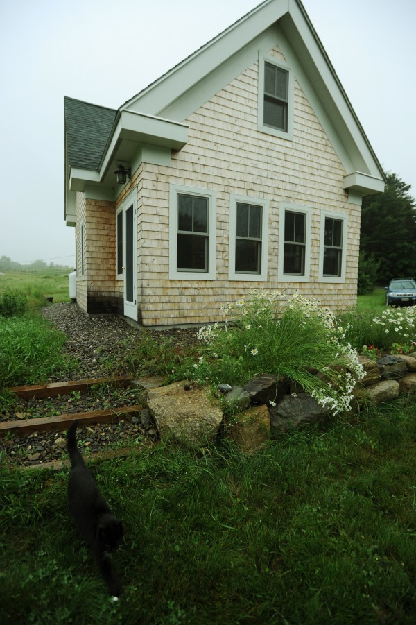 The exterior southwest view of one of Jim Bahoosh's New England-style farmhouses as seen on Saturday, June 25, 201 in Morrill.