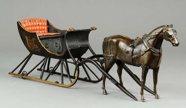 The sleigh with walking horse is a very rare cast iron toy by Ives. It sold for $86,250 this spring at Bertoia Auctions in New Jersey.