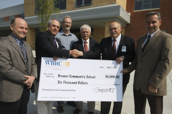 Brewer School Superintendent Dan Lee (second from right) accepts a $6,000 donation from WBRC Architects-Engineers to purchase a Steinway piano for the new Performing Arts Center at Brewer Community School. With Lee are (from left) Steve Pedersen, Steve Rich, Mark Chambers, Cal Bubar and Ray Bolduc.