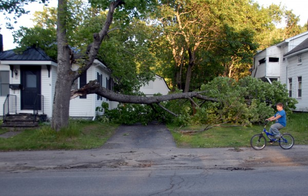 Fifteen-year-old Cody Crocker rides his bicycle past an