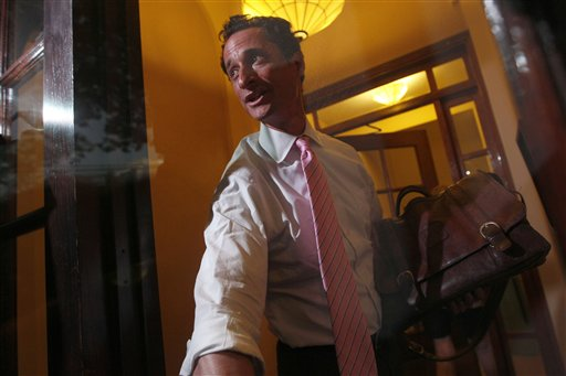 Rep. Anthony Weiner, D-N.Y., closes the front door of his building on reporters as he arrives at his house in the Queens borough of New York on Thursday, June 9, 2011. Weiner admitted that he had Tweeted sexually charged messages and photos to at least six women and lied about it.